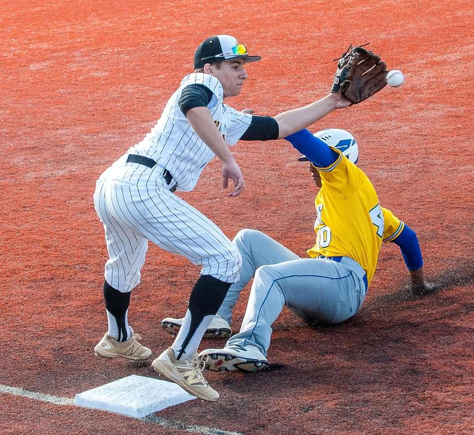 Kellenberg's Jason Diaz slides in safe at third
