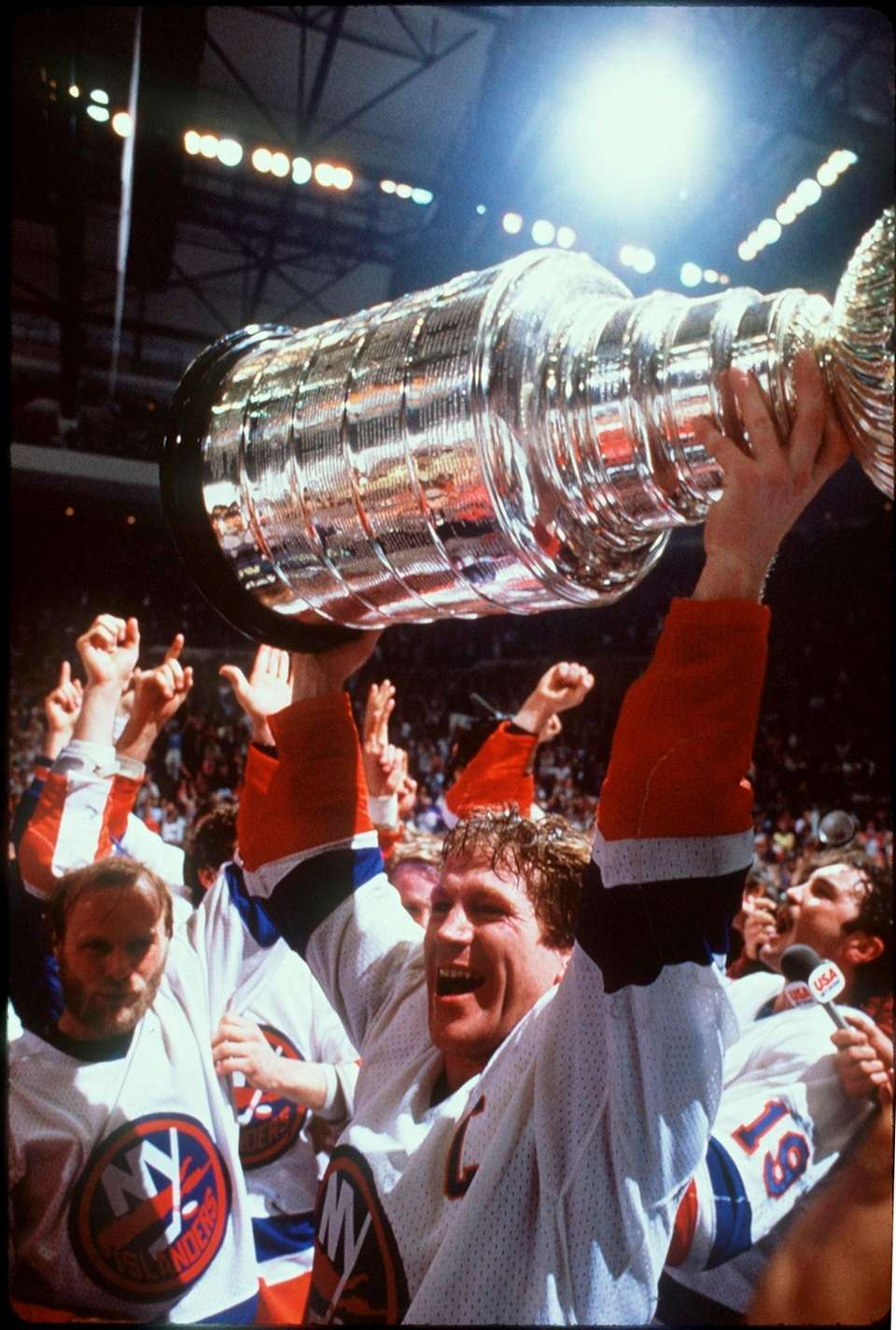 Denis Potvin hoists the Stanley Cup after the