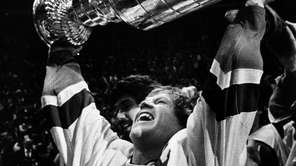 Islanders captain Denis Potvin hoists the Stanley Cup
