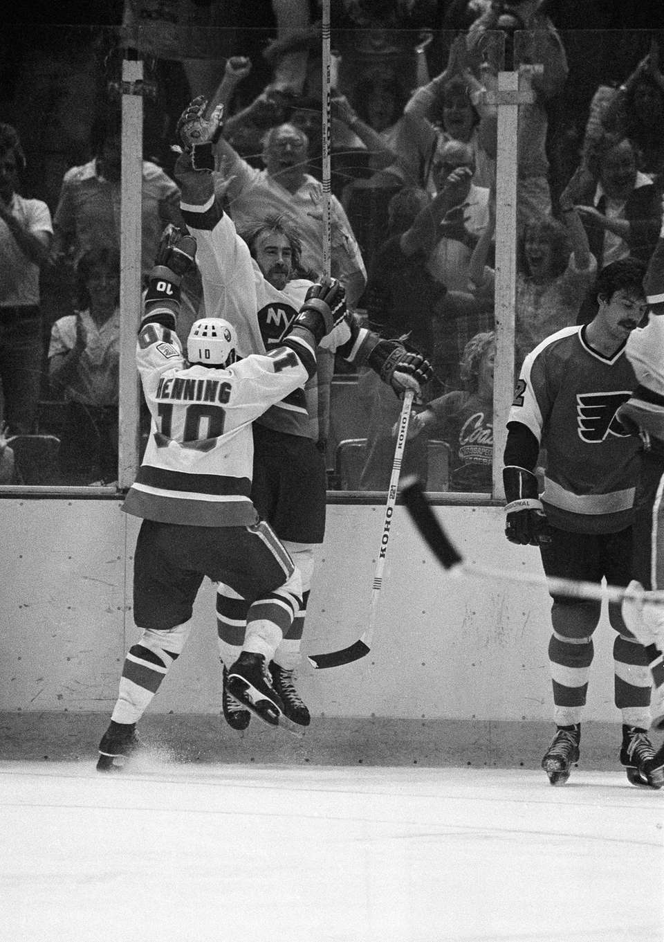 Bob Nystrom of the New York Islanders leaps