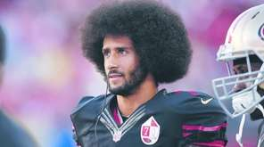 Colin Kaepernick of the San Francisco 49ers stands