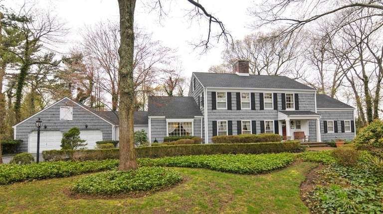 This five-bedroom, 4½-bath Colonial in Smithtown is listed