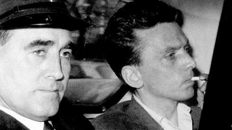 Ian Brady, at right, arrives at court in