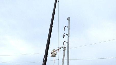 PSEG Long Island crews put up a steel