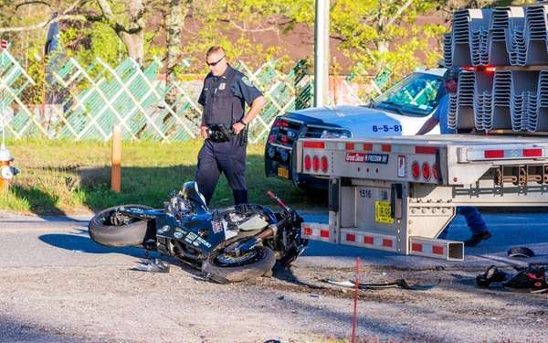 A motorcyclist was taken to the hospital with