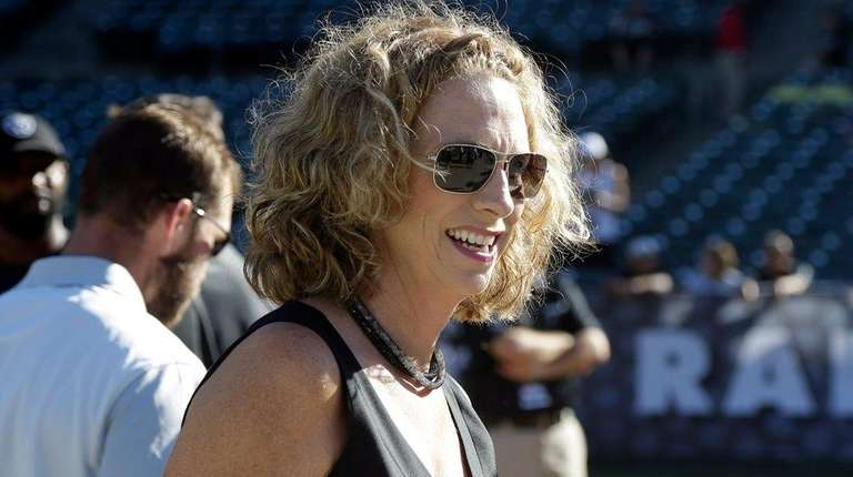 Announcer Beth Mowins walks on the field before