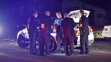 Suffolk County police investigate a home invasion on