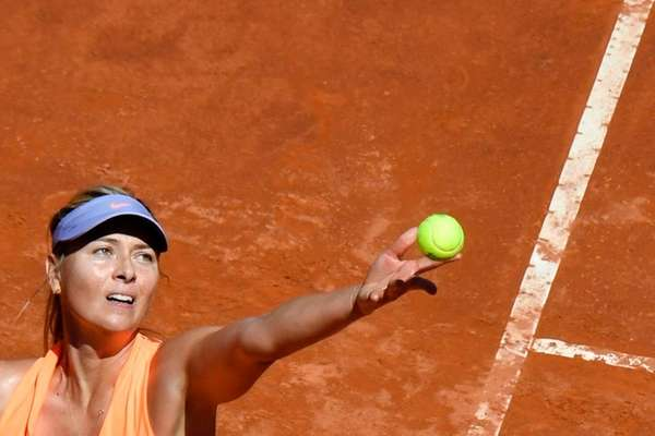 Maria Sharapova serves against Christina McHale during the