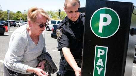 A public safety officer helps Joan Laidlaw, of