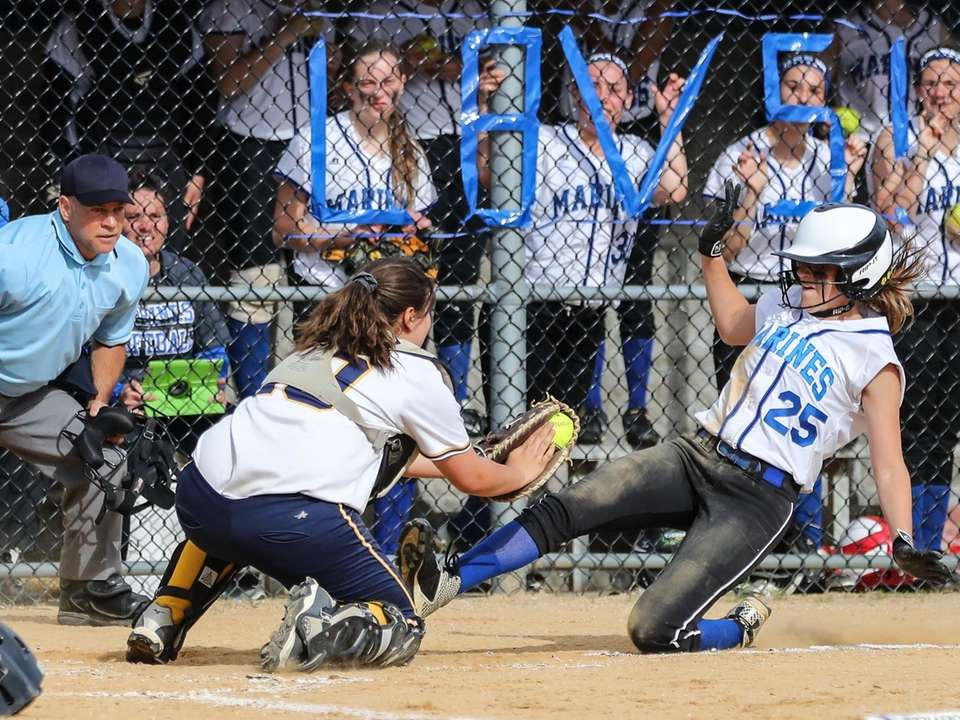 Massapequa catcher Ellie Egher puts the tag on