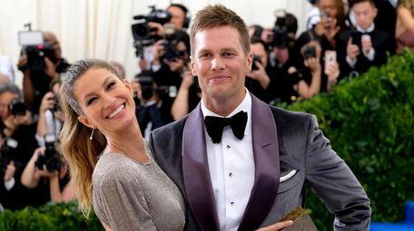Gisele Bundchen, left, and Tom Brady attend The