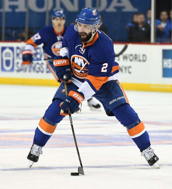 New York Islanders defenseman Nick Leddy controls the