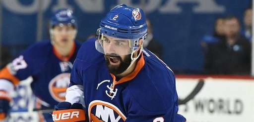 New York Islanders defenseman Nick Leddy controls the
