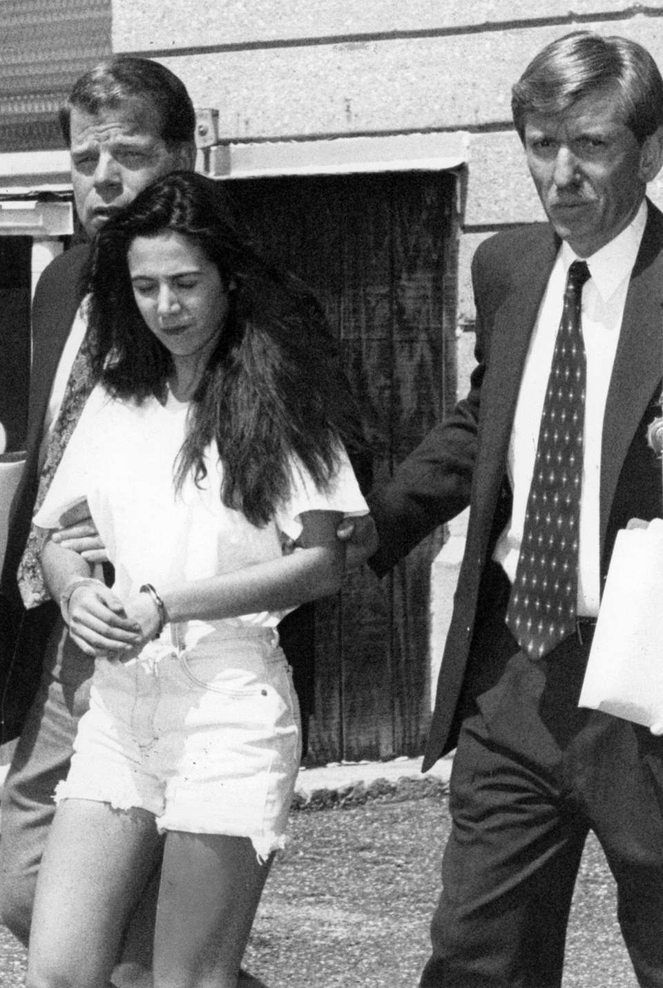 Amy Fisher, 17, is led away in handcuffs