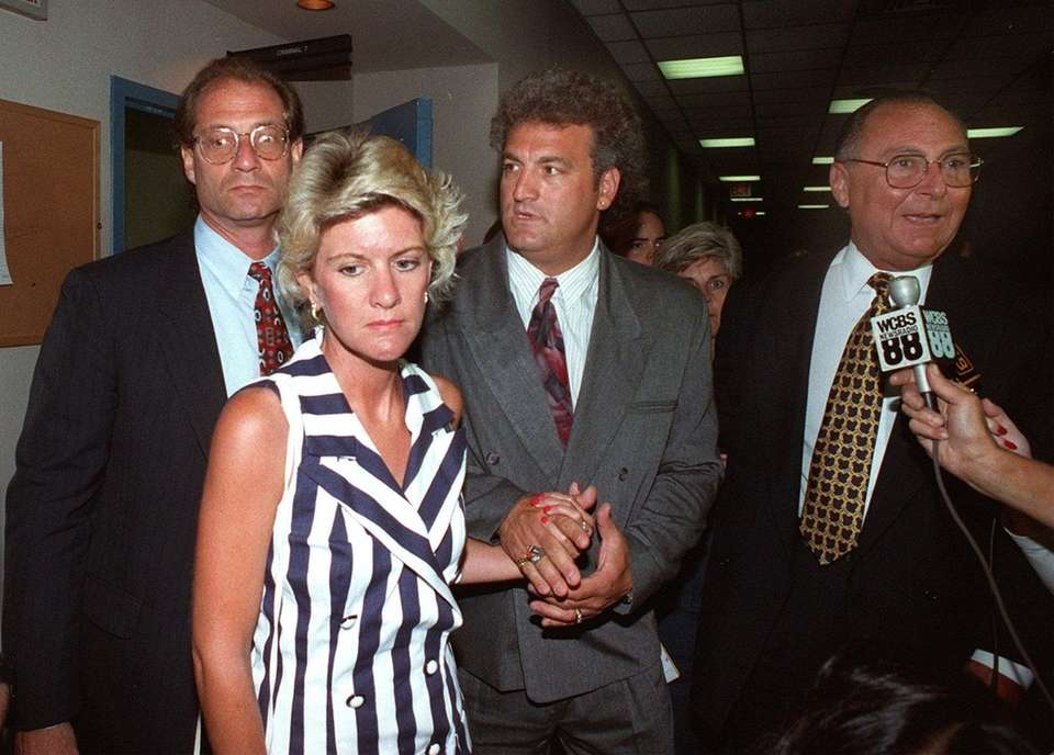 Attorney Ed Shulman, left, Mary Jo Buttafuoco, second
