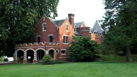 This 19-bedroom Lloyd Harbor Tudor is one of