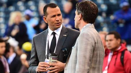 New York Yankees Alex Rodriguez speaks with Kevin