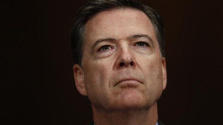 Former FBI Director James Comey listens on Capitol