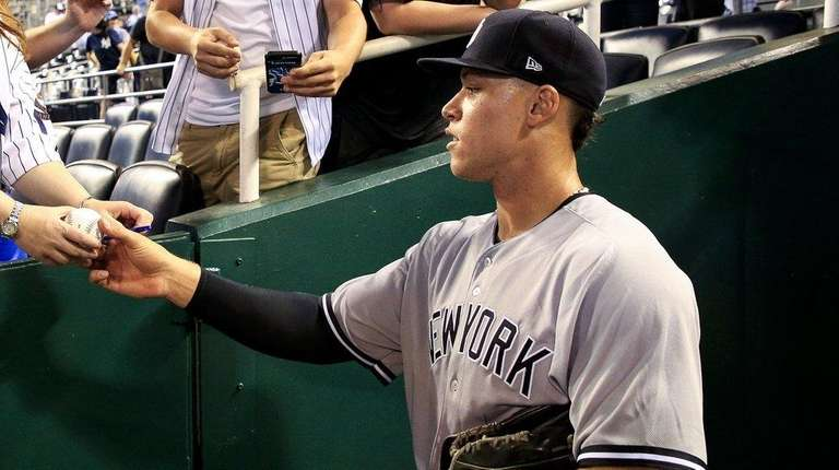 Aaron Judge of the New York Yankees signs