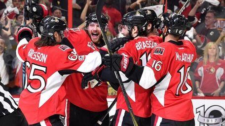 Marc Methot of the Ottawa Senators celebrates with