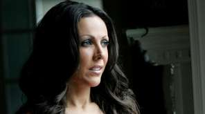 Amy Fisher poses at her home on July