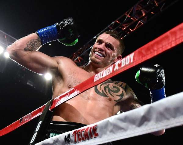Long Island's Joe Smith Jr. reacts after punching Bernard