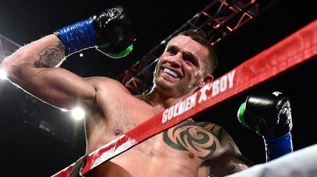 Long Island'sJoe Smith Jr. reacts after punching Bernard