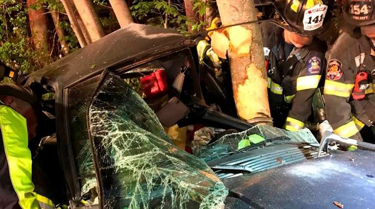 Firefighters rescued a driver who crashed into a