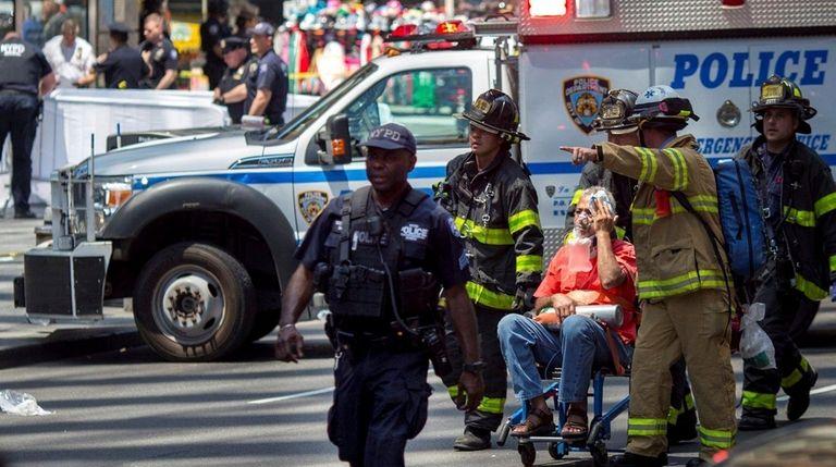An injured pedestrian is taken to an emergency
