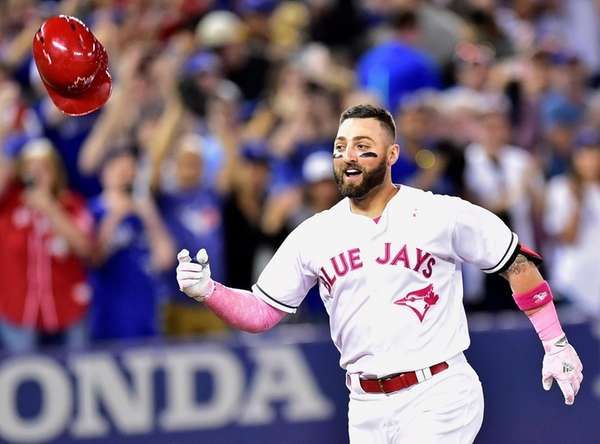 Toronto Blue Jays outfielder Kevin Pillar (11) celebrates