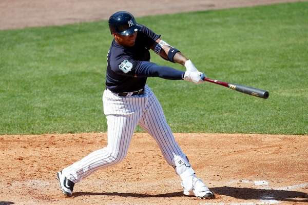 Gleyber Torres of the Yankees hits a solo