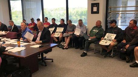 Ten striking employees of beer distributor Clare Rose