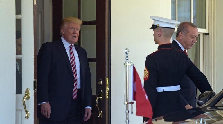 President Donald Trump walks Turkish President Recep Tayyip