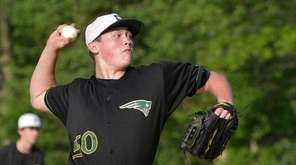 Ward Melville's Drake Eggleston (50) throw to the