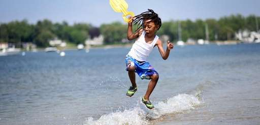 Keon Cantave, 5, of Huntington, jumps over small