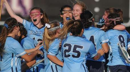 Our Lady of Mercy teammates celebrate after their