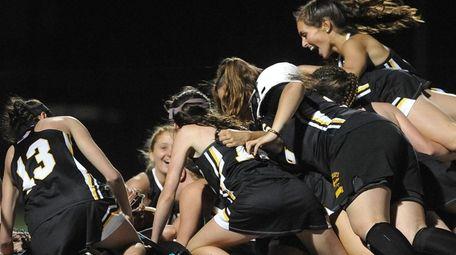 St. Anthony's varsity girls lacrosse teammates celebrate after