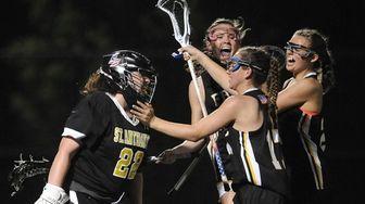 Delaney Galvin, St. Anthony's goalie, gets mobbed by