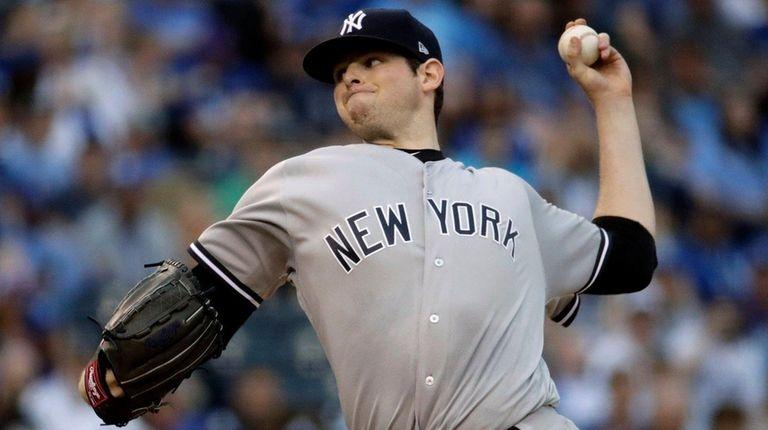 Yankees starting pitcher Jordan Montgomery throws during the