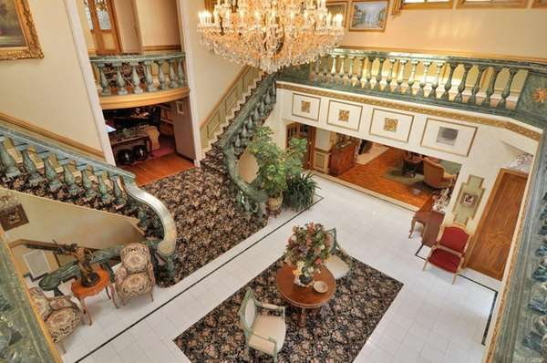 This seven-bedroom mansion's center hall foyer has 36-foot