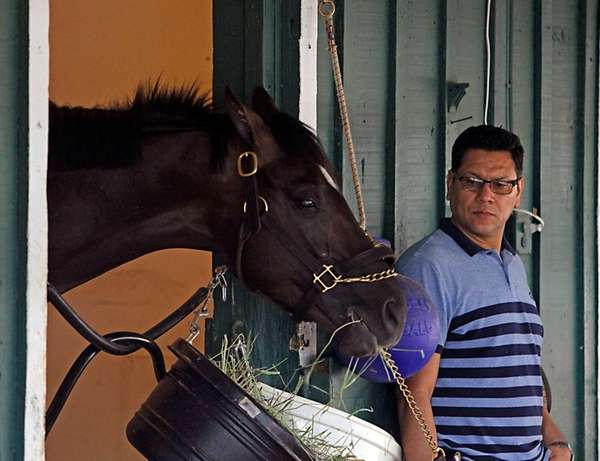 As foreman Juan Aguayo looks on, Kentucky Derby