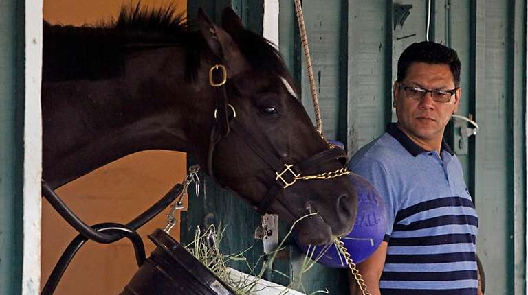 As foreman Juan Aguayo looks on, Kentucky Derby