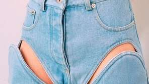 Designed by Y/Project, these bleached denim cutout jeans,