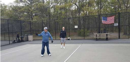 Herb Weismandel, left, and Tony Morena play handball