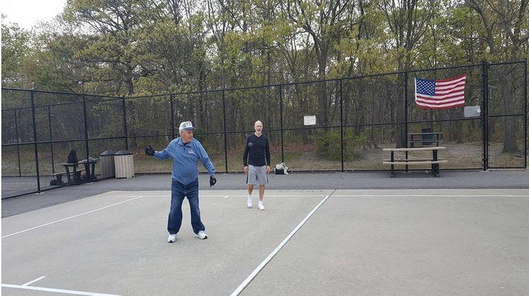 Herb Weismandel, left, and Tony Morena play handball
