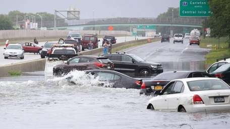 Cars are stuck in floodwaters on Sunrise Highway