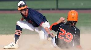 Manhasset's Robert Giovanelli receives the ball as Carey's