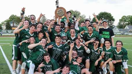 Holy Trinity celebrates its victory in the CHSAA