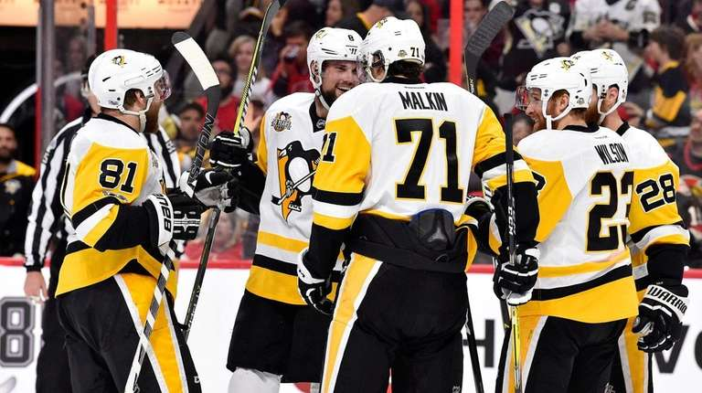 Brian Dumoulin of the Pittsburgh Penguins celebrates with
