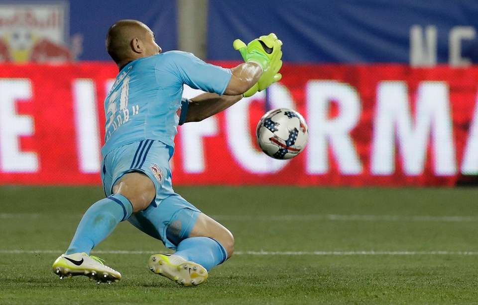 New York Red Bulls goalkeeper Luis Robles stops